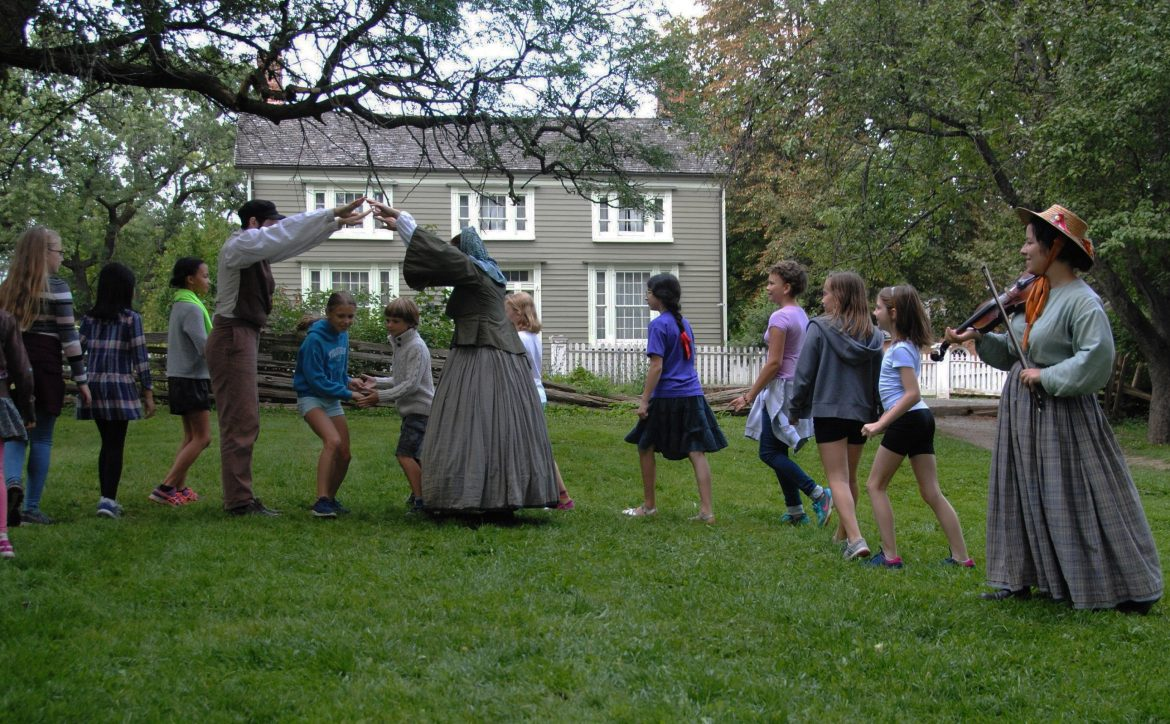 children learn traditional dance from history actors at Black Creek Village