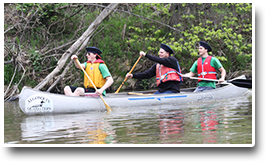 3 people in a canoe on the Don River