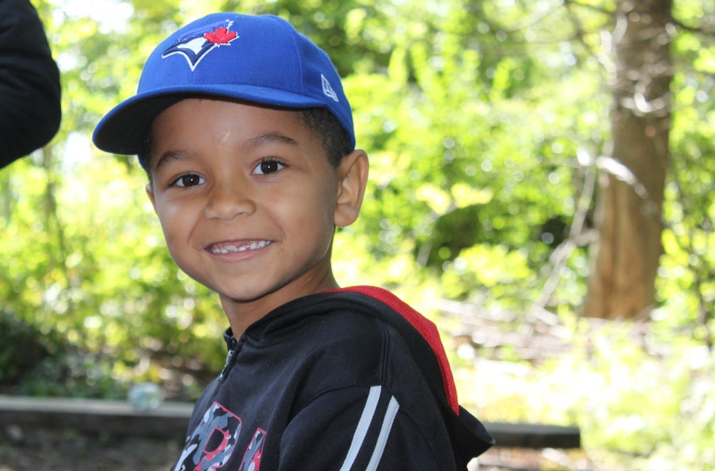 young boy takes part in TRCA nature camp