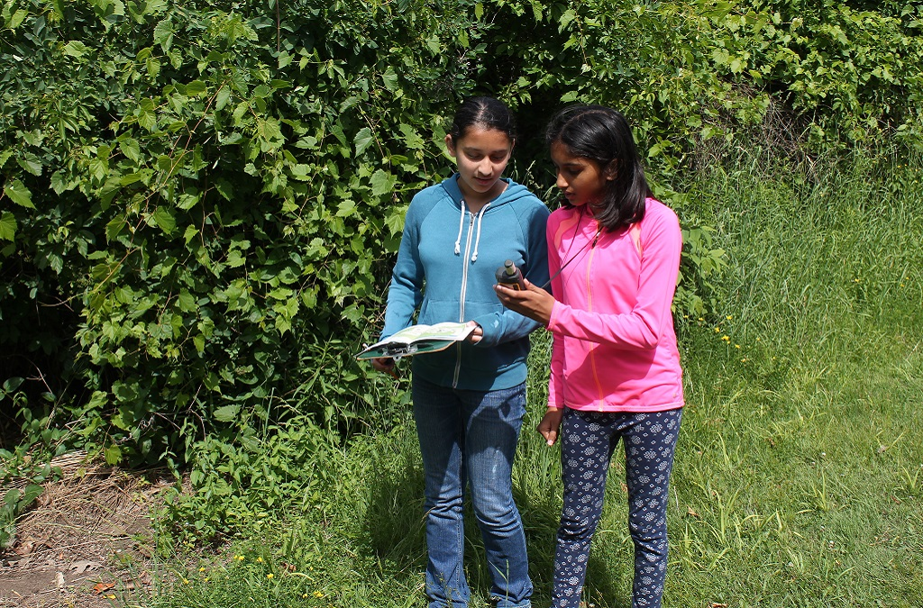 girls practice orienteering during field trip at Claremont Nature Centre