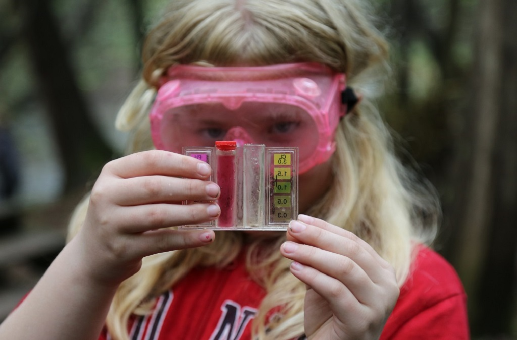 girl tests water sample during TRCA education program at Claremont Nature Centre