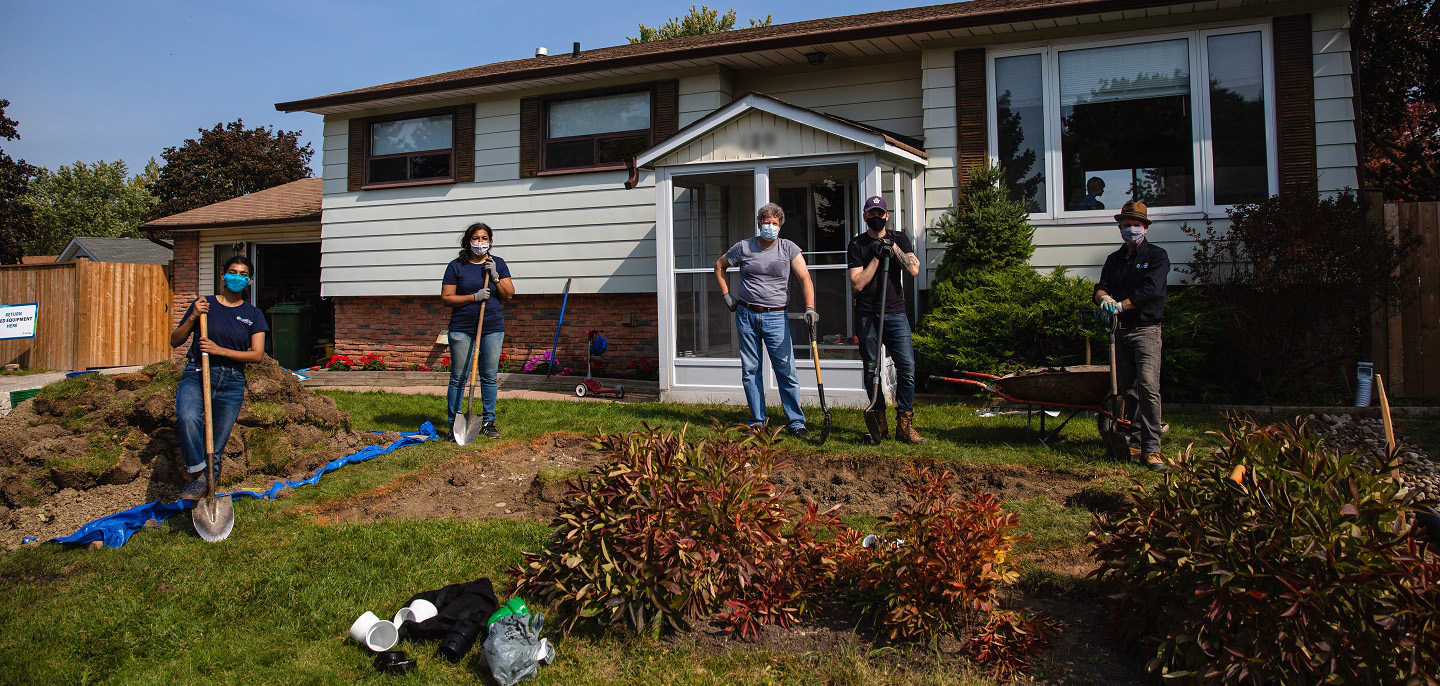 community volunteers take part in creating a rain garden in the West Bolton SNAP neighbourhood