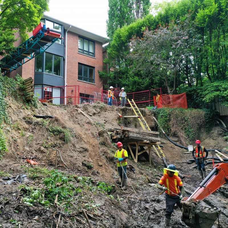 TRCA Erosion Risk Management staff work on a slope stabilization project behind a private residence