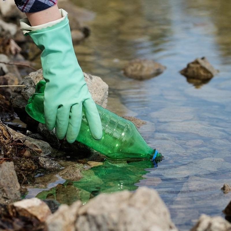 community member participates in shoreline cleanup event