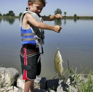 A boy with a fish